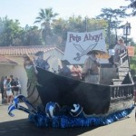 Pirates make their way through the parade.